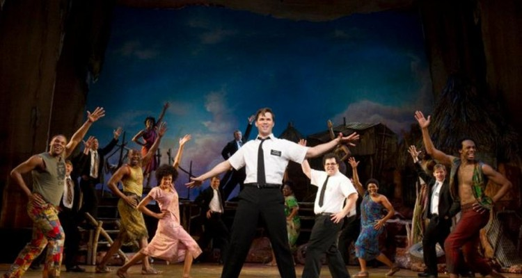 LATTER-DAY SAINT OF LAUGHS: Andrew Rannells (center) & the cast of the hilarious 'The Book of Mormon.' Photo: Joan Marcus